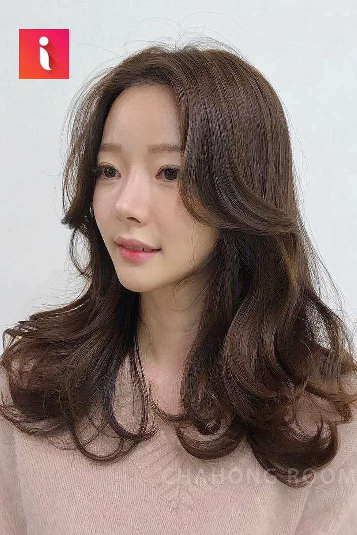 Tóc ngắn ngang vai đẹp xoăn sóng tạo độ bồng bềnh cho mái tóc và cảm giác dày dặn